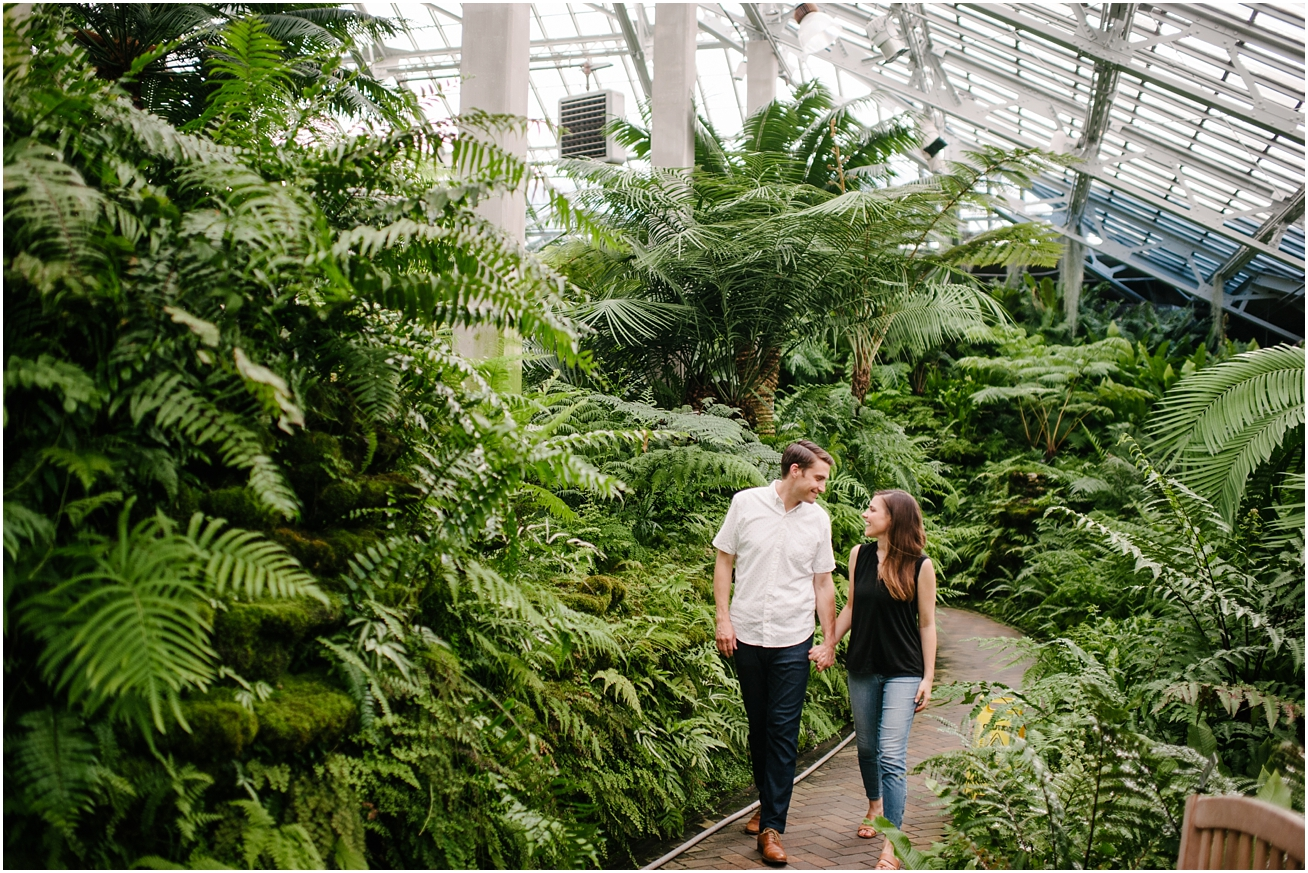 couple walking through the plants at Garfield Park Conservatory